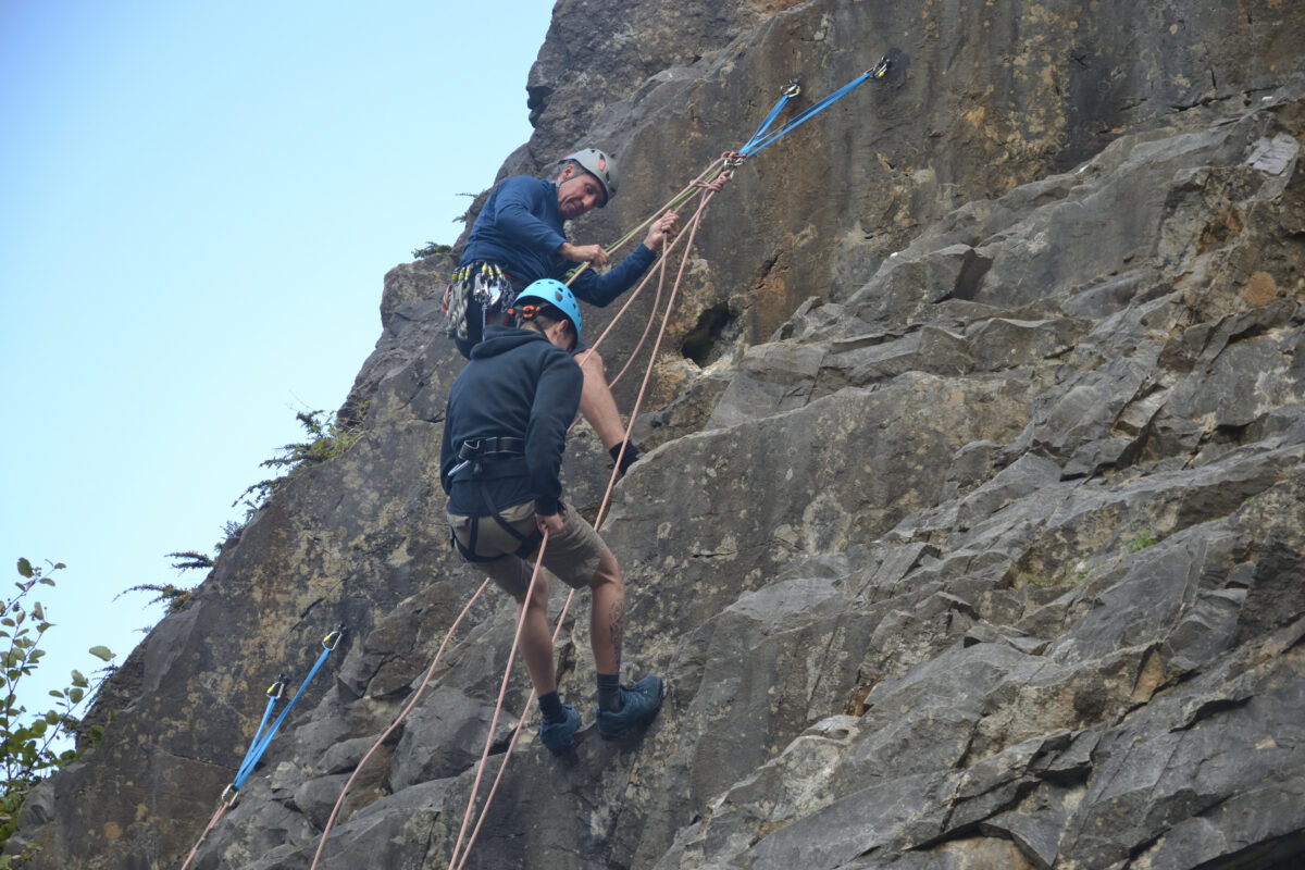 Neil teaching someone to abseil