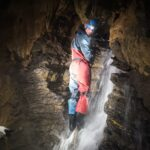 Wet caving adventure, the Mendips, N. Somerset