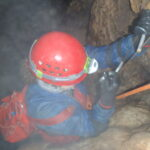 Wet adventure caving - ladder descent!